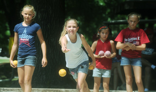 Globe/Roger Nomer<br /> (from left) Zoe Pinamonti, Jordan Akins, Sophie Chiappetti and Taylor Hurt, all 10 years old, watch a critical throw in their Bocce game at Lincoln Park during Pittsburg's Fourth of July celebration.