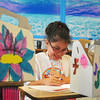Globe/Roger Nomer<br /> Courtney Brown, 10, works on her introduction biography at Camp Noah at Immanuel Lutheran Church on Monday morning.