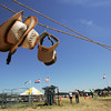 Globe/Roger Nomer<br /> Sunscreen and hats were requirements for the day at a hot Four State Farm Show on Friday.