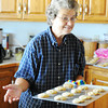 Globe/T. Rob Brown<br /> Bonnie Grace pulls a freshly baked sheet of cookies from her convection oven Tuesday morning, July 24, 2012, in her rural Sarcoxie home.