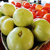 Globe/T. Rob Brown Green and other tomatoes from Nhia & Ying Xiong produce of Anderson Friday morning, June 29, 2012, at the Webb City Farmers' Market.