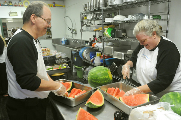 Globe/Roger Nomer<br /> Jeff and Ginger Reppond share a laugh while preparing a meal at Souls Harbor on Wednesday, July 4, 2012.