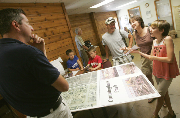 Globe/Roger Nomer<br /> Chris Cotten, Joplin Parks and Rec director, talks with (from left) William, 9, James, 9, Gene, Amy and Sarah, 13, Connor before Wednesday's check presentation.