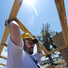 Globe/T. Rob Brown<br /> Matt Berry, St. Louis Blues premium sales executive, braves the heat to help carry a trussel for a Habitat for Humanity home Wednesday afternoon, July 25, 2012, near the intersection of 24th Street and Picher Avenue.