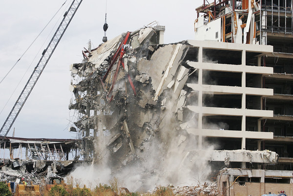Globe/Roger Nomer<br /> A wrecking ball demolishes part of the middle portion of St. John's Hospital on Thursday afternoon.