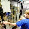 Globe/T. Rob Brown<br /> David Green, 11, of Joplin, volunteers from St. Mary's Catholic Church, with Crosslines food pantry to fill orders Friday afternoon, July 13, 2012.