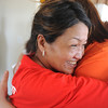 Globe/Roger Nomer<br /> Joy Thompson, left, gets a welcome home hug from fellow Habitat recipient Alissa Gutierrez on Friday afternoon.