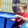 Globe/Roger Nomer<br /> Marcus Hill, Jr., 5, Pittsburg, rides an amusement ride at Lincoln Park in Pittsburg as part of the city's Fourth of July activities on Wednesday.