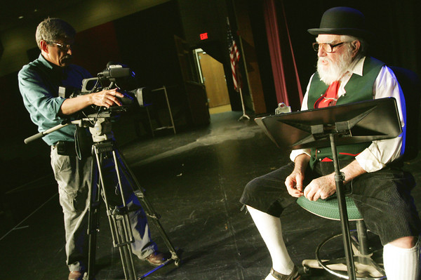 Globe/Roger Nomer<br /> Jim Kelly, with Sunflower Journeys, films Bill Sollner reciting a piece as the narrator at Pittsburg High School on Thursday.