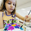 Globe/T. Rob Brown<br /> Kate Derdowski, who will be starting kindergarten this coming school year, paints a sculpture on canvas Friday afternoon, July 27, 2012, during summer school at Thomas Jefferson Independent Day School.