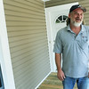 Globe/Roger Nomer<br /> Aubrey Holmes talks about the remodel of his house, including his front porch, done by HOME during an interview on Thursday.