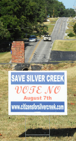 Globe/T. Rob Brown<br /> A sign against the consolidation of Silver Creek into the city of Joplin is displayed in the yard of a residence on Silver Creek Drive, near Marjorie Lane Thursday evening, July 19, 2012.