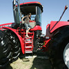 Globe/Roger Nomer<br /> Sarah Zimmerman, 10, McCune, Kan., carefully climbs down from the cab of a large tractor at the Four State Farm Show on Friday.