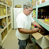 Globe/Roger Nomer<br /> Calvin Thomas unloads a shipment of food stuffs at Wesley House in Pittsburg on Friday.