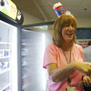 Globe/Roger Nomer<br /> Edie Ingram, program manager for Childrens Miracle Network Hospitals, sells a Dairy Queen Blizzard at Freeman West Hospital on Thursday afternoon.  Dairy Queen and Childrens Miracle Network teamed up for Miracle Treat Day, and up to a third of the proceeds of the sales at Freeman West went to help local families.  One hundred Blizzard treats were sold in the hospital's cafeteria in a little over an hour.