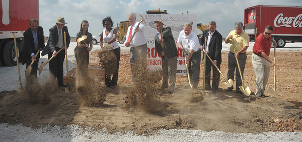 Globe/Roger Nomer<br /> Ground is broken for the new Coca-Cola bottling plant at the Crossroads Business Center on Monday morning.