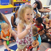 Globe/Roger Nomer<br /> Caelyn Bobske, 4, demonstrates her sign language skills for the class at Kids Korner Daycare.