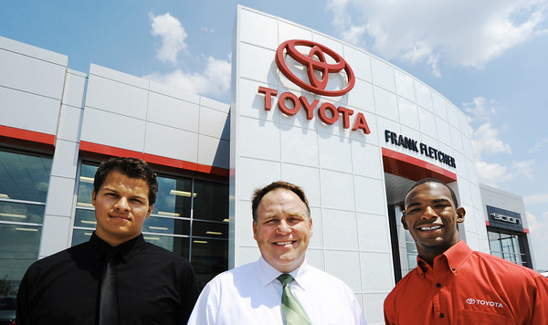 Globe/T. Rob Brown<br /> Frank Fletcher Toyota employees, from left, Tucker Taylor, Toyota sales professional, General Manager Jim Adams and Ishmael Hankins, Toyota/Scion sales professional, stand in front of the new sales office on South Range Line Road.
