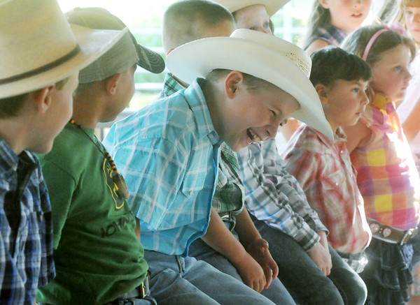 Globe/Roger Nomer<br /> Nathaniel Hudson, 8, Carthage, cracks up with his fellow Country Little Mister contestants at the Jasper County Fair on Tuesday.