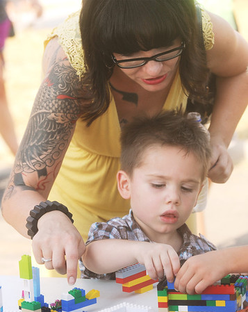 Globe/Roger Nomer<br /> Sabrina Hayes helps her son Hunter, 3, with a Lego project after receiving the keys to their new Habitat home on Friday.