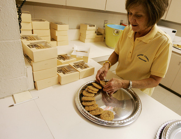 Globe/Roger Nomer<br /> Jasper County Treasurer Jeannie Wells arranges cookies before Monday's Lincoln Ladies Social at Memorial Hall in Carthage.