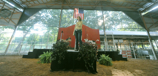 Globe/Roger Nomer<br /> Jasper County Fair queen contestant Sarah Cooper sings for her talent presentation on Tuesday evening in the main arena.
