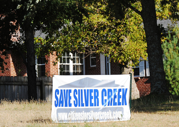 Globe/T. Rob Brown<br /> A sign against the consolidation of Silver Creek into the city of Joplin is displayed in the yard of a residence on Silver Creek Drive, near Range Line Road, Thursday evening, July 19, 2012.