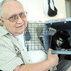 Globe/Roger Nomer<br /> Milo Harris displays his cat Bootsie in a pet carrier, because the cat is too traumatized to be held.