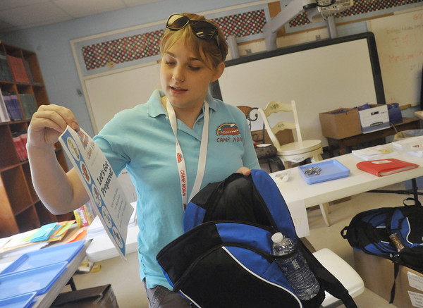 Globe/Roger Nomer<br /> Tiffany Falley talks about the contents of preparedness backpacks given to children at Camp Noah.