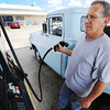 Globe/T. Rob Brown Gary Weywrick, of Joplin, tops off the tank on his 1957 Ford F-100, which gets about 12 miles to the gallon, with $3.02 gas Monday afternoon, July 2, 2012, at the convenience store at 2703 E. 32nd St.
