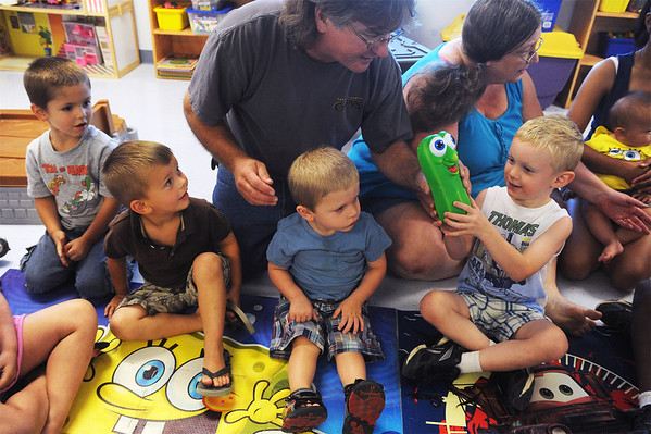 Globe/Roger Nomer<br /> Ray Malcom plays a game of hot potato with (from left) James Lafever, 4, Brayden Wright, 3, Landon Wors, 2, and James Holifield, 5, at the Kids Korner Daycare.