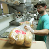 Globe/Roger Nomer<br /> Jeff Schmitt preps sandwich buns at the Mall Deli in Pittsburg on Tuesday morning.