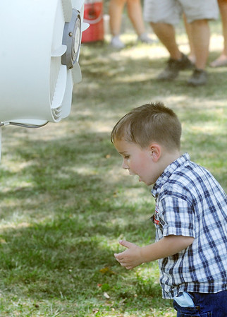 Globe/Roger Nomer<br /> Dyaln Sams, 2, uses a misting fan to cool off at Lincoln Park during Pittsburg's Fourth of July celebration on Wednesday.