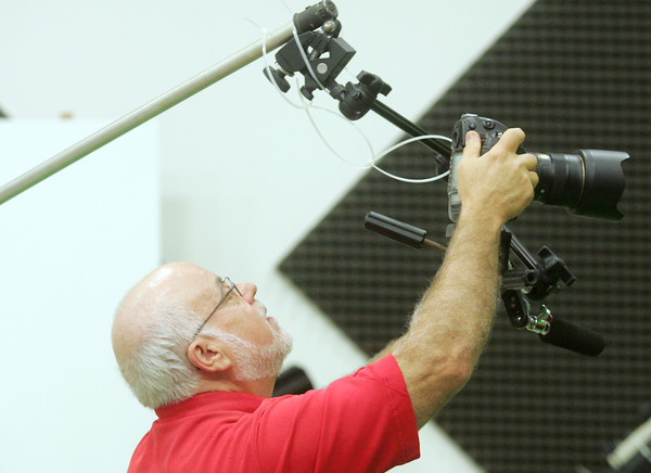 Globe/Roger Nomer<br /> Malcolm Turner lines up a shot as he prepares for a video shoot at Pittsburg State University on Friday.  Turner has seen many technological changes in photograpy over his career at PSU.