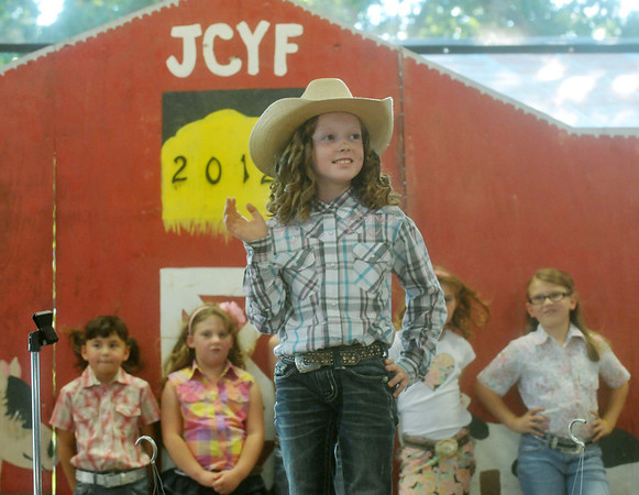Globe/Roger Nomer<br /> Country Little Miss contestant Lauren Wilson waves to the crowd during her introduction at the Jasper County Fair on Tuesday.