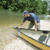 Globe/Roger Nomer<br /> Pat Tinsley prepares a boat for launch at Big Elk Campground on Tuesday.