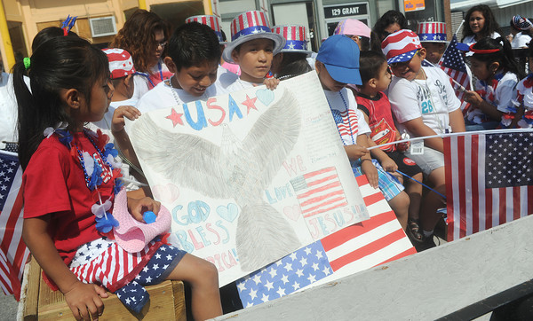 Globe/Roger Nomer<br /> Children board a float before the start of the Fourth of July parade in Carthage.  Area Hispanic churches organized the holiday parade.