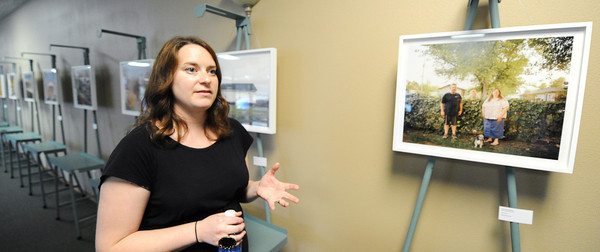 Globe/T. Rob Brown<br /> Brooklyn, New York, photographer Dina Kantor talks about her experience photographing the people of Treece, Kan., during a reception Tuesday night, July 2, 2013, for the Treece display at the Baxter Springs Heritage Center & Museum.