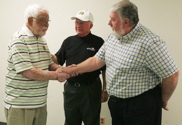 Globe/Roger Nomer<br /> Former Joplin mayors (from left) Larry Hickey, Richard Russell and Gary Shaw say their farewells after a reunion on Friday at Central Christian Church.