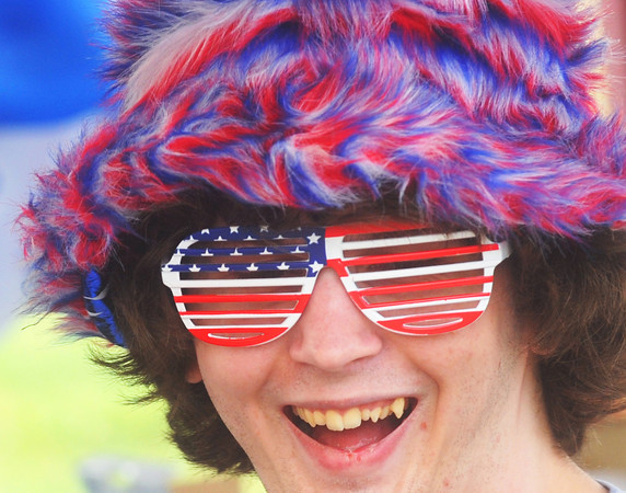 Globe/Roger Nomer<br /> Joshua Brock, Joplin, sports a colorful hat and shades while at Landreth Park for the Fourth of July festivities on Thursday.