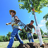 Globe/T. Rob Brown<br /> Ozark Nursery laborers Curt Collins (left) and John Shreve plant one of 67 trees delivered to Campbell Parkway Tuesday morning, July 9, 2013. The full project includes a total of 1,530 native Missouri trees about 12 to 14 feet tall, including sycamores, birch, bur oak, red oak and a couple maple varieties.