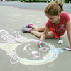 Globe/Roger Nomer<br /> Catherine Rhoads, 9, Springfield, draws a chalk figure while attending Camp  V on Wednesday morning.  The summer activity camp was held at Victory Ministry and Sports Complex.