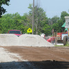 Globe/Roger Nomer<br /> Workers with Carterville Public Works resurface Hall Street on Friday morning.  The effort is part of a plan to eventually resurface all the streets in town.