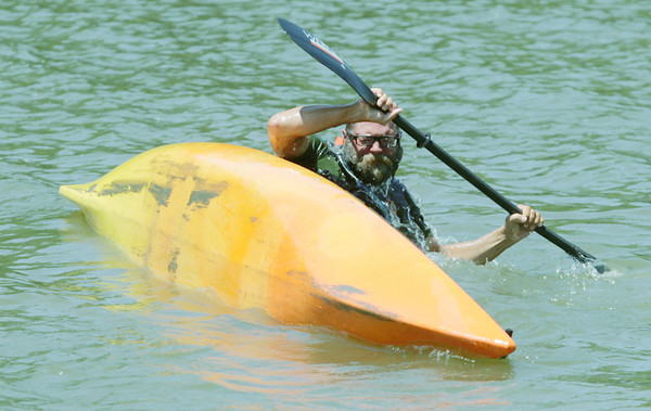 Globe/Roger Nomer<br /> In celebration of reaching the end of his journey, Will Hembree does a couple of rolls in his Kayak at Twin Bridges State Park on Tuesday.