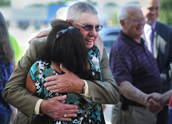Globe/T. Rob Brown<br /> Bill Compton, a Con-way Truckload driver, gets one of many hugs Wednesday morning, July 17, 2013, outside the company's Joplin headquarters. Compton has logged 4 million miles operating tractor trailers.