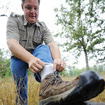 Globe/T. Rob Brown Kevin Badgley, community outreach specialist with the Missouri Department of Conservation, performs a sock tuck Friday morning, July 26, 2013, outside the Wilcat Glades Co ...