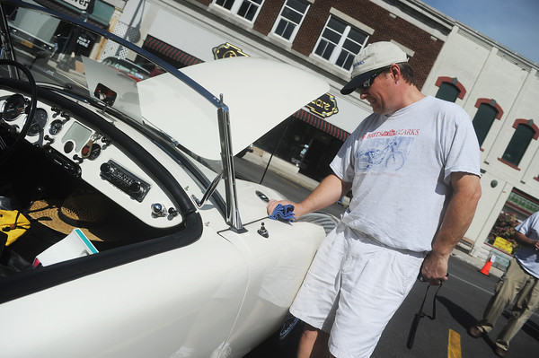 Globe/Roger Nomer<br /> Bryson Porter, Fayetteville, Ark., wipes down his 1958 MGA during the Greater Ozarks British Motor Car Show on the Carthage square on Saturday.  This is the 14th year for the show.