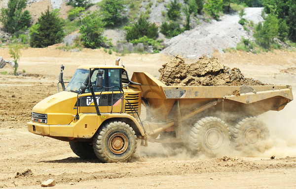 Globe/T. Rob Brown<br /> Another load of dirt is moved near the Oronogo Circle mine pit Thursday afternoon, July 11, 2013.