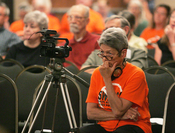 Globe/Roger Nomer<br /> Sandy Martin, Eureka Springs, Ark., observes and records Monday's hearing at the Inn of the Ozarks Conference Center.