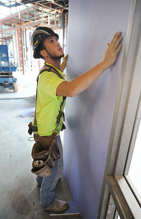 Globe/T. Rob Brown<br /> Daniel Neff of Springfield, a carpenter with Midwest Drywall of Springfield, installs sheet rock Tuesday, July 16, 2013, at the new Irving Elementary School.
